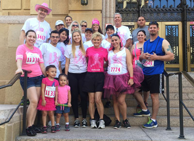 Staff members from Gallagher & Kennedy law firm, along with members of their families, participated in this year's Susan G. Komen Phoenix Race for the Cure to support one of their own—Colleen Bergsten (center front, in the dark pink shirt), who has been battling breast cancer for 21 years. Bergsten also was joined by her daughter, Rachel (pictured to her left) and husband, Steve (second from right, back row, in white T-shirt), who have walked with her for several previous races (submitted photo).