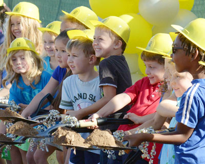 """Dozens of students at Madison Simis took turns participating in the ceremonial groundbreaking of their new school on Sept. 30. Each student at Simis that day was given the opportunity to participate and """"turn the dirt"""" (submitted photo)."""