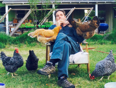 """The home of """"urban farmer"""" Bryan White, who likes to entertain his flock with a little music, will be on this year's Tour de Coops, featuring a variety of backyard chicken coops and other permaculture ideas that can be incorporated into an urban environment (submitted photo)."""