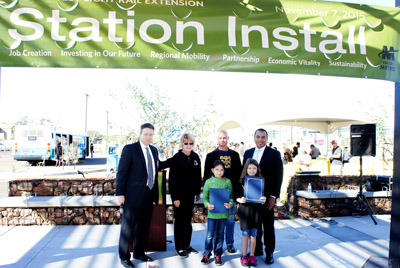 Avril Nevarez Loya (front left) and Laura Page, both students at Richard E. Miller Elementary, were honored for their original artwork that was used at the new light rail station at 19th and Dunlap avenues as part of the Station Install event on Nov. 7. Congratulating the two 9-year-old girls are, from left: Paul Stanton, superintendent for the Washington Elementary School District; District 1 Councilwoman Thelda Williams; Matthew Salenger, the artist who design and created the central gathering place with yellow cone-like installations; and District 5 Councilman Daniel Valenzuela (photo by Teri Carnicelli).