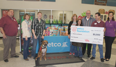 Celebrating the gifting of a $5,000 grant from the Petco Foundation to Boxer Luv Rescue are, from left: Petco District Manager Ted Holub; Susanne Kogut, executive director of the Petco Foundation; Kristy Wolfmeyer and her service-dog-in-training, Koa; Teresa Whitt, manager of Petco in Tempe; Sara Piscopo, Petco store manager at 45th St. and Thomas Road; Randy Rotondo, president of the Boxer Luv Rescue Board of Directors; Bryan Harns, district manager for Petco; and Yvonne McVay of Halo Purely for Pets (photo by Teri Carnicelli).