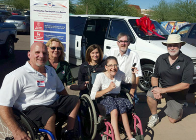 Celebrating the donation of a wheelchair-accessible 1995 Dodge Grand Caravan to the Johnson family of North Central Phoenix are, from left: David Martin of Martin's Auto Repair in Phoenix; RaeAnn Hayward of NARPRO; Karen and Johnny Johnson; Jim Garland of Hi-Tech Car Care, and Ashleigh Johnson in front (submitted photo).