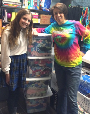Mia Scardello, left, recently donated nearly 400 pairs of fuzzy socks to Lorraine Tallman, right, founder of Amanda Hope Rainbow Angels. The socks will be add to care packages put together by Tallman and handed out to families who have a child diagnosed with cancer or other blood-related disorders and who are receiving out-patient and in-patient services at Phoenix Children's Hospital (submitted photo).