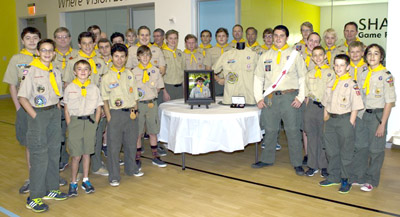 Celebrating the awarding of the Eagle Rank, given posthumously to Austin Lipko-Benito, are members of Boy Scout Troop 329 at the Foundation for Blind Children facility, the beneficiary of Austin's Eagle project. With them are framed photo of Austin, his uniform shirt, and his Eagle patch and award (submitted photo).