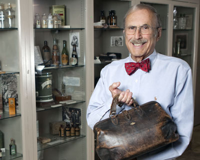 Robert Kravetz, creator and curator of the Abrazo Central Campus's Medical Museum, displays an old doctor's satchel (submitted photo).