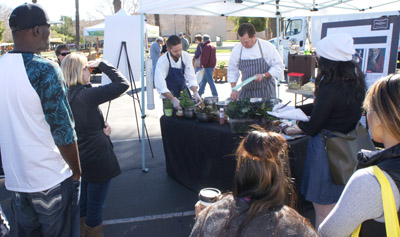 Chef Joe Hobson, center left, and Executive Chef Jeremy Pacheco of Lon's at the Hermosa Inn help celebrate the Uptown Wednesday Market's first anniversary with a special demo and tasting that highlighted ingredients available at the market (photo by Teri Carnicelli).