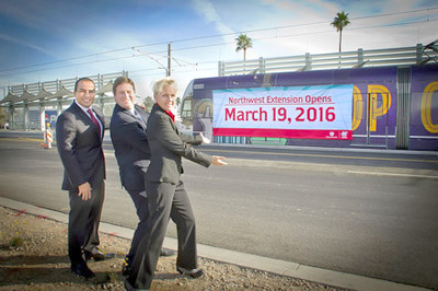 From left: Phoenix Vice Mayor Daniel Valenzuela, Phoenix Mayor Greg Stanton and Valley Metro Safety and Security Director Adrian Ruiz reveal the Northwest Extension's opening date during a special event on Dec. 10 (submitted photo).