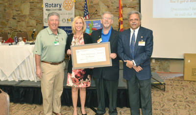 Celebrating the donation of $10,000 to Homeless Youth Connection from Phoenix Rotary 100 are, from left: Steve Sussman, president of Homeless Youth Connection; Dawn Bogart, executive director of HYC; Howie Simon, past president of Phoenix Rotary 100; and Tony Kakar, president of Phoenix Rotary 100 (submitted photo).