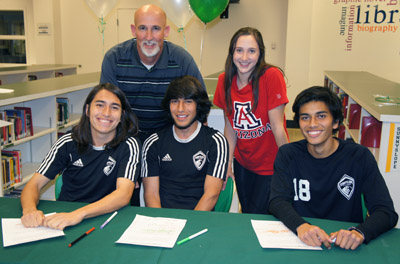 Mike Fenton, soccer coach at Sunnyslope High School, congratulates his college-bound student athletes, counter-clockwise: Brynn Moga, Junior Gonzales, Sebastian Arellano, and John Kanner (photo by Teri Carnicelli).