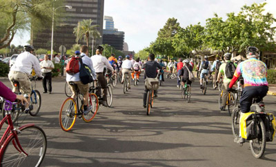 Bicycle riders set off from the parking lot at Park Central Mall and head toward downtown Phoenix as part of the annual Phoenix/Maricopa Bike to Work Day, which takes place this year from 7-9 a.m. on Wednesday, April 20 (photo courtesy of the city of Phoenix).