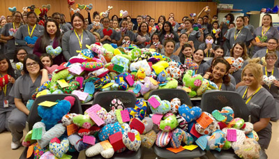 Students at Carrington College's North Campus in Phoenix prepare to deliver more than 500 handmade pillows to patients at Phoenix Children's Hospital (photo courtesy of Carrington College).