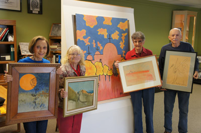 Displaying some of the artwork by Bennie Gonzales that will be available for purchase at the Sunnyslope History Museum this month are Sunnyslope Historical Society members, from left: Bobbie Kraver, Donna Peterson, Connie Kreamer and Richard Solem (photo by Teri Carnicelli).