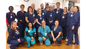 Some of the members of the Progressive Cardiovascular Care Unit at HonorHealth John C. Lincoln Medical Center, standing, from left: Registered Nurses Scholastica Masioge, Susie Laird, Beth Cooke, Kristin Tirado, Samantha Valcarce, Chuck Balcome, and Maria Gates; Clinical Director Wilma Perkes; Nursing Supervisor Kevin Merk; and Registered Nurses Dianna Jackson, Nancy Engle, and Christine Leibering. Kneeling, from left: Jamie Wrede, RN; Sezaline Rogers, PCT; Frank Villa, PCT; and Diana Martinez, RN (submitted photo).