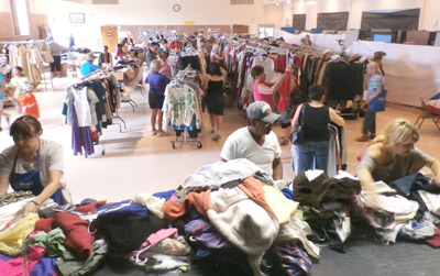 Bargain shoppers looking for great deals on gently used clothing sift through the thousands of pieces of apparel featured during the annual five-day rummage sale hosted by Our Lady of the Assumption Sodality at St. Thomas the Apostle Church (submitted photo).