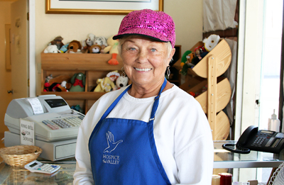 Volunteer Shay Butler at the White Dove thrift store in Central Phoenix (submitted photo).