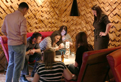 Visitors to the Linger Longer Lounge can enjoy some game time with their food and drinks. No, not dozens of TVs showing local sports, but some real hands-on gaming, whether Jenga, Sorry, or other fun retro board games that fill the shelves in the game room (submitted photo).
