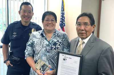 Former North Central Phoenix Patrol Officer Emma Nez retired last month from the Phoenix Police Department after 30 years of service. Sgt. Steve Ong served as emcee at her retirement party, and Hopi Tribal Chairman Herman Honanie presented her with a plaque for her outstanding service. Nez is Hopi from First Mesa, Ariz. (photo by Patty Talahongva).