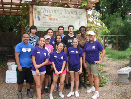 Members of the Washington High School Interact Club, led by club advisor Jill Green (far right), volunteer twice a month in the fall at the Grown Together: A Giving Garden, located on the grounds of Living Streams Church (submitted photo).