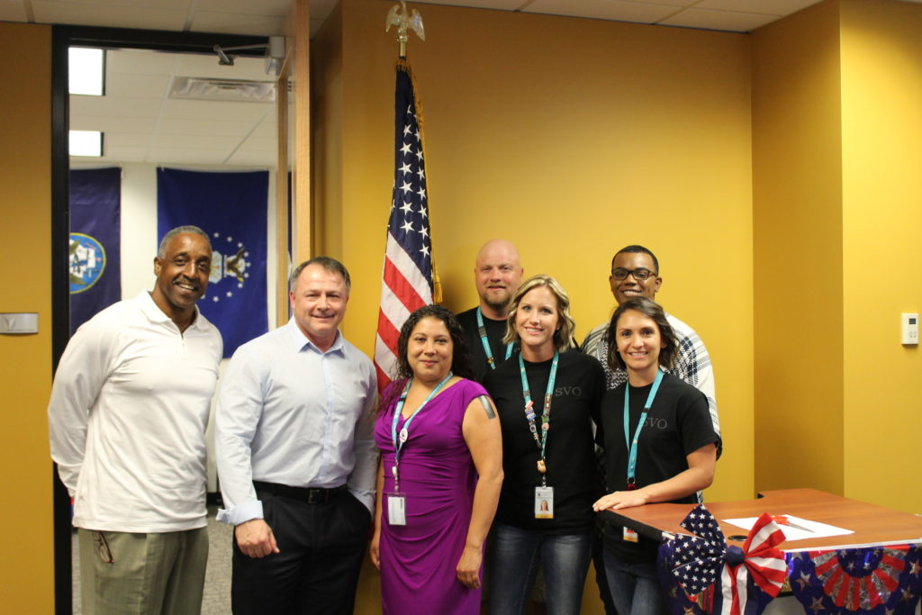 From left: Guest speakers Carl Hardgrave, former NFL coach, and Mike Broomhead, Morning Drive host for News Talk 550 KFYI, at the unveiling of the Veterans' Resource Room at DeVry's campus in Phoenix with the campus Veterans Club leadership: Angela White (president), Douglas Brook, April Rosscup, Joseph Guevara and Laura Saenz (submitted photo).