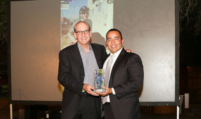 Phoenix City Councilman Daniel Valenzuela (right) presents the Lou & Evelyn Grubb Community Innovator Award to Rick Naimark during the Fifth Annual Mayor's Arts Awards, held on Oct. 13 in downtown Phoenix (photo by Enrique Garcia).
